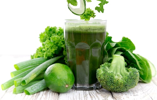 green vegetable juice with lime after juicing